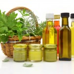 Fresh herbs in wicker basket and all-natural cosmetics
