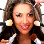 woman with all the tools for makeup surrounding her face